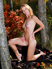 Diana Bronce bares her meaty ass and puffy tits outdoors.