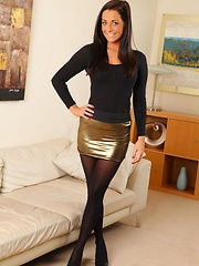Stunning brunette in gold shiny miniskirt with opaque pantyhose