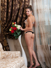 Etna  is a blue-eyed cutie who loves showing off her tight, dancer's physique with flexible, wide open poses.